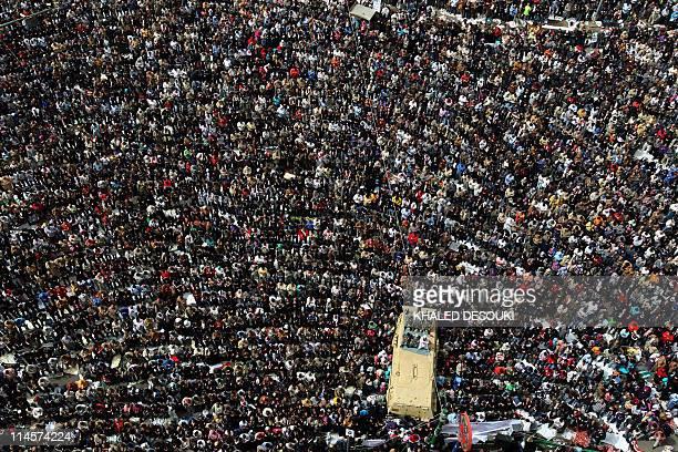 تركستان الشرقية تستنصركم.. Thousands-of-egyptians-perform-the-friday-prayer-in-cairos-tahrir-on-picture-id114574224?s=612x612