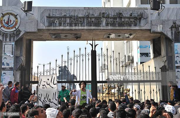 Thousands of Egyptians rally on February 17 closing down government offices and factories in the Suez Canal city of Port Said as they demand justice...