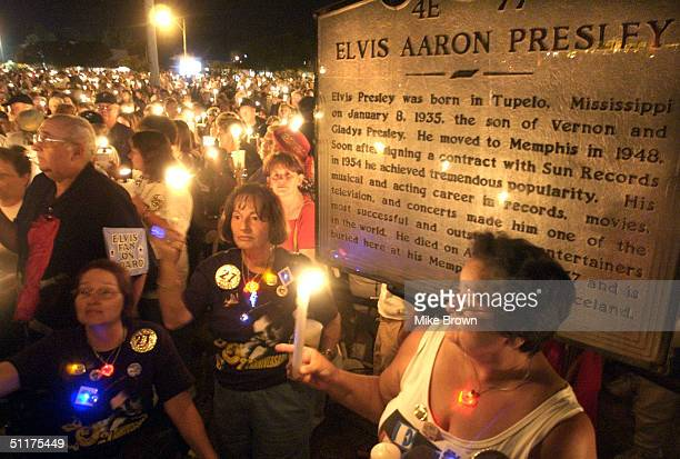 Thousands of Elvis fans hold their candles during the annual candle light vigil August 15, 2004 at Graceland in Memphis, Tennessee. The vigil is the...