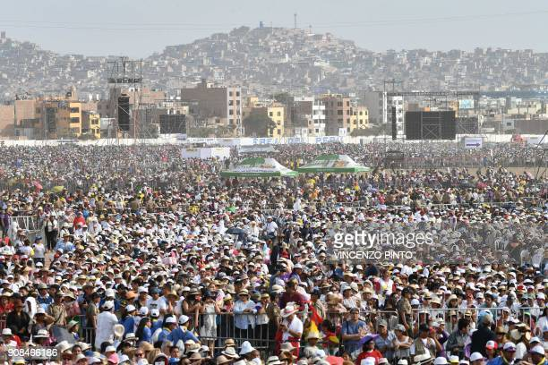 Thousands of faithfuls attend a mass celebrated by Pope Francis at the Las Palmas air base in Lima on January 21 2018 Pope Francis was preparing to...