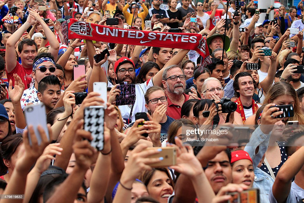Thousands of fans cheer as the 2015 United States Women's National Soccer Team takes the stage after winning the FIFA Women's World Cup at a free, public championship celebration at L.A. Live's Microsoft Square in Los Angeles, Calif., on July 7, 2015.