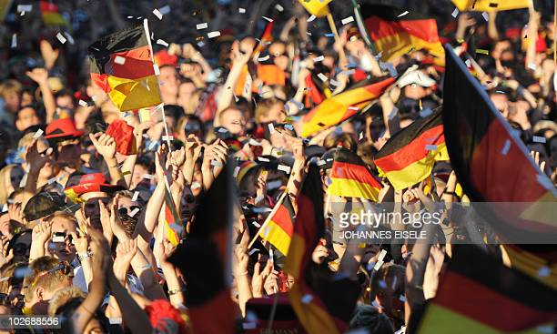 Thousands of fans of the German national football team cheer during the public viewing at the Fanmeile in Berlin on July 7 of the FIFA World Cup...