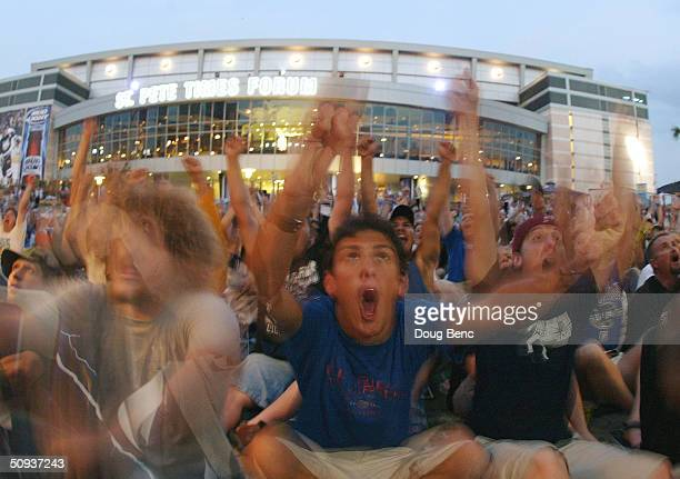 Thousands of fans that couldn't get tickets, cheer as theTampa Bay Lightning score against the Calgary Flames from outside the St Pete Times Forum in...