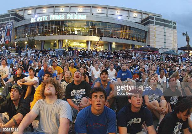 Thousands of fans that couldn't get tickets watch the Calgary Flames take on the Tampa Bay Lightning from outside the St Pete Times Forum in game...