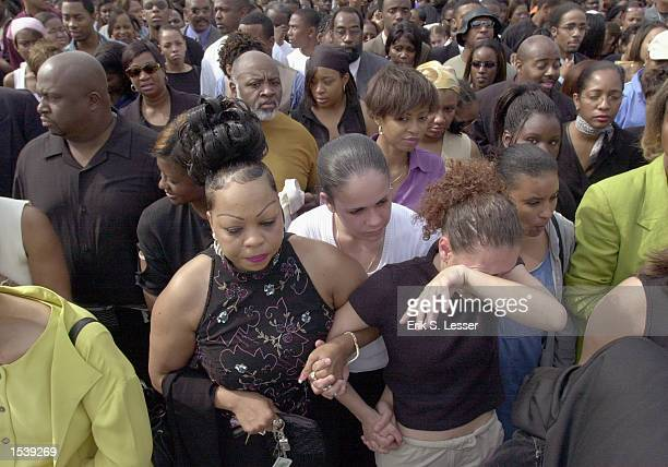 Thousands of fans wait in line to attend the public funeral for singer Lisa Left Eye Lopes at the New Birth Missionary Baptist Church May 2 2002 in...