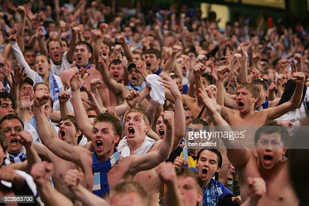 Thousands of FC Zenit St Petersburg fans take off their shirts and sing during the UEFA Cup Final between FC Zenit St Petersburg and Rangers FC at...