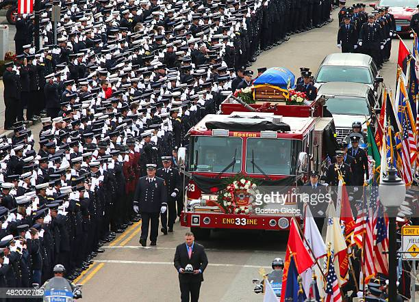 Thousands of firefighters from across the country took part in the funeral services for Boston Fire Lt Edward J Walsh Jr at St Patrick's Church in...