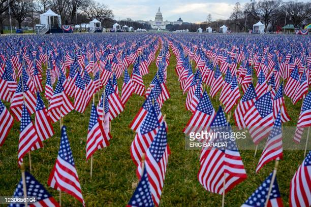 """Thousands of flags creating a """"field of flags"""" are seen on the National Mall ahead of Joe Biden's swearing-in inauguration ceremony as the 46th US..."""