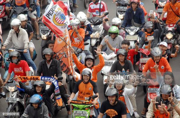 Thousands of football fans of Persija while passing through the Hotel Indonesia roundabout to celebrate the victory in Jakarta On February 182018 The...
