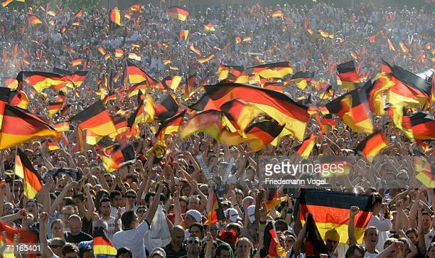 Thousands of football fans with German national flags celebrate the start of the World Cup 2006 at the 'Heiligengeistfeld' a public viewing zone in...