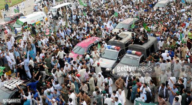 Thousands of former Prime Minister of Pakistan Nawaz Sharif's supporters gather during his departure from Islamabad to Lahore on Wednesday to show...
