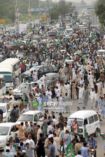 Thousands of former Prime Minister of Pakistan Nawaz Sharif's supporters gather to show solidarity during his departure from Islamabad to Lahore on...