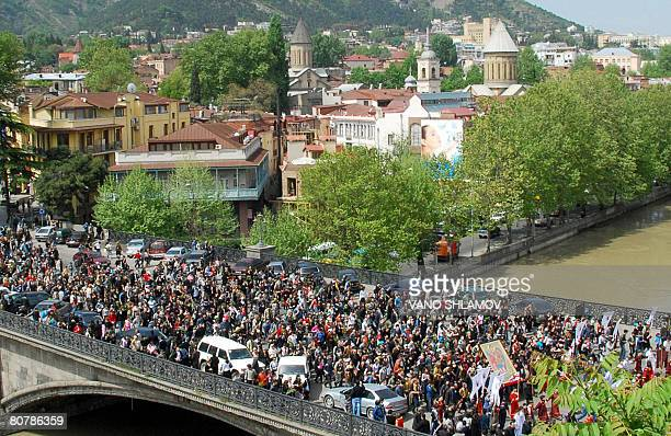 Thousands of Georgian Orthodox believers march along a bridge over the Kura river in downtown Tbilisi on April 20 celebrating Palm Sunday The armed...