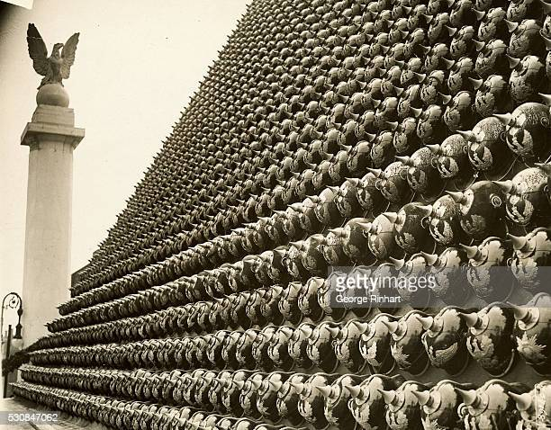 Thousands of German helmets fastened to a wall in preparation of victory parade to pass through London
