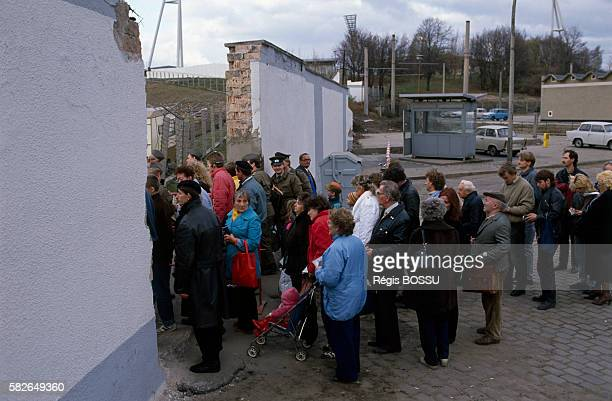 Thousands of Germans cross the border between East and West Germany for the first time in over 20 years