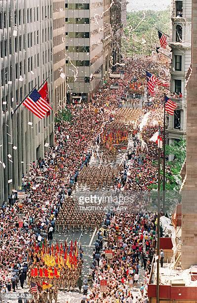 Thousands of Gulf War veterans are showered with tickertape as they march up Broadway Avenue during the Operation Welcome Home parade during the 10...