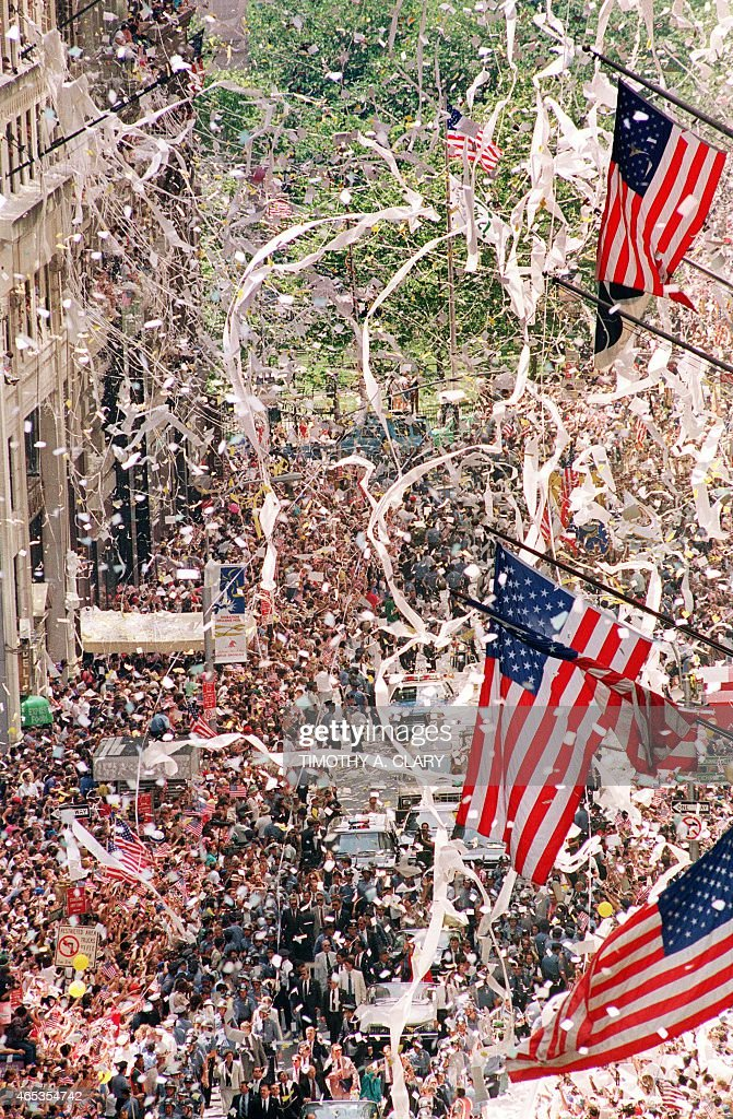 Thousands of Gulf War veterans are showered with ticker-tape as they march up Broadway Avenue during the Operation Welcome Home parade during the 10 June 1991 celebration for returning Gulf War troops.