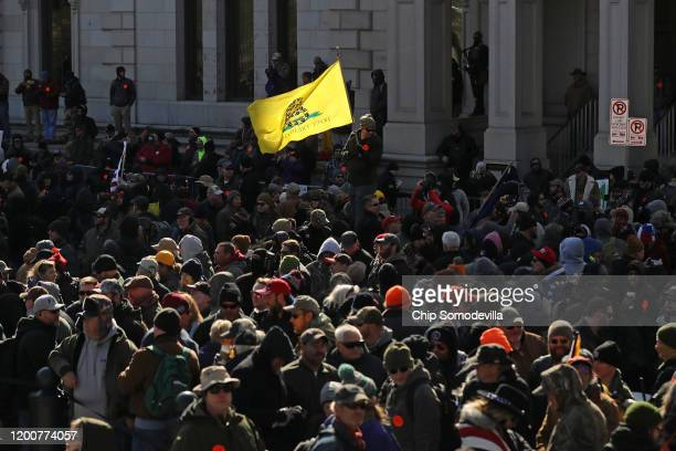 Thousands of gun rights advocates gather on the street just outside a rally organized by The Virginia Citizens Defense League on Capitol Square near...