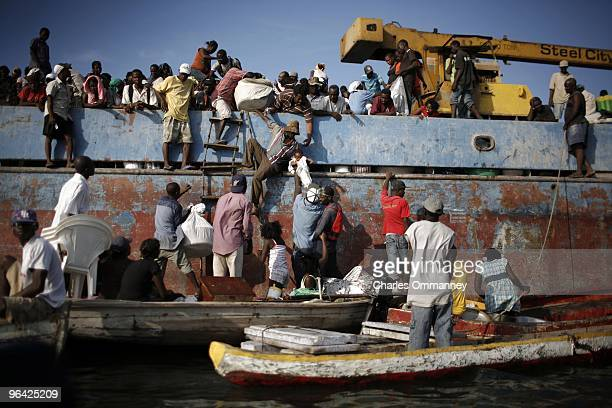 Thousands of Haitians boarding boats to get away from Port au Prince on January 20 2010 in Port Au Prince Haiti