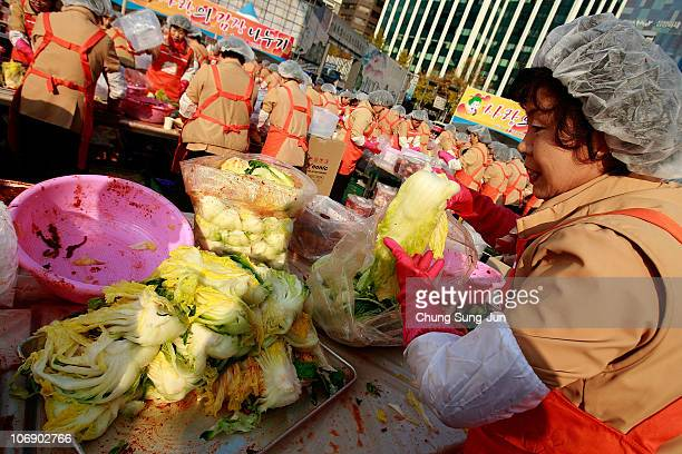 Thousands of housewives make Kimchi for donation to the poor in preparation for winter in front of City Hall on November 16, 2010 in Seoul, South...