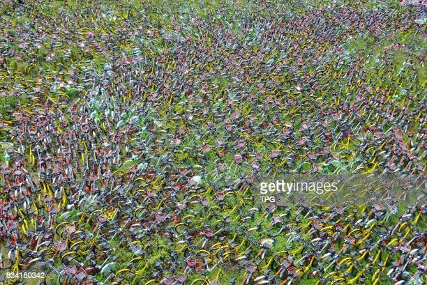 Thousands of illegally parked share bikes temporary detained in a sports field on 17th August 2017 in Hefei Anhui China