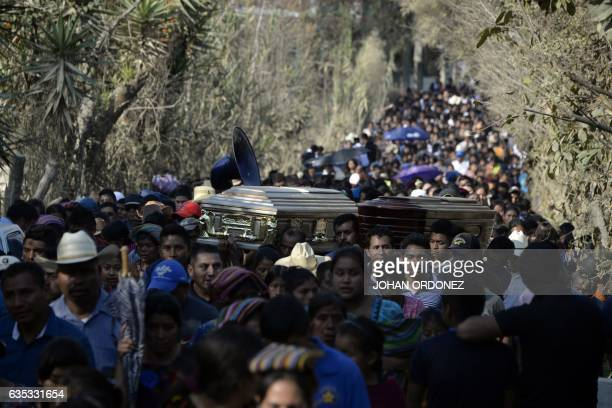 TOPSHOT Thousands of indigenous Guatemalans accompany to the cemetery the coffins of two children killed by their kidnappers in the Cerro Alto...