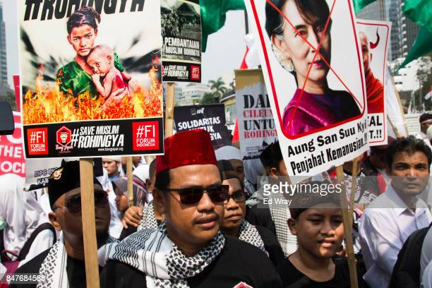 Thousands of Indonesian Muslims demonstrate in support of the Rohingya ethnic group who are being pushed out from their homes in Myanmar on September...