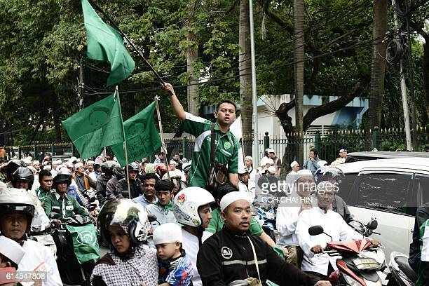 Thousands of Indonesian Muslims march in protest against Jakarta governor Basuki Tjahaja Purnama known by his nickname Ahok outside his office in...