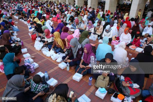 Thousands of Indonesian people break their fast at the Istiqlal Mosque in Jakarta Indonesia Every day during the holy month Ramadan board of the...