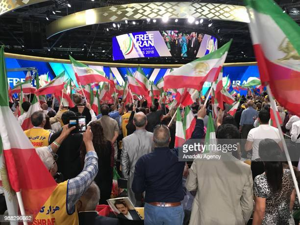 Thousands of Iranians gather during the event organized by National Council of Resistance of Iran at the Parc des Expositions de Villepinte in Paris,...