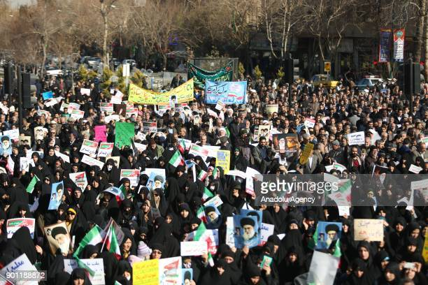 Thousands of Iranians hold banners and posters as they take part in a progovernment rally in Isfahan Iran on January 4 2018