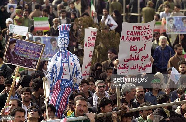 Thousands of Iranians mark the 23rd anniversary of the Islamic Revolution by chanting Death to America and burning American flags and effigies of US...