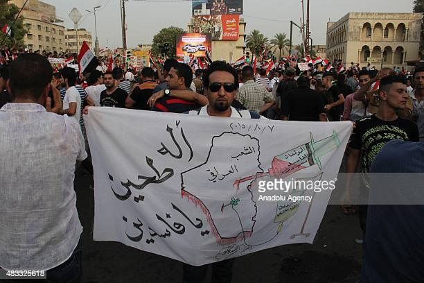 Thousands of Iraqi demonstrators gather at Tahrir Square to protest power cuts in Baghdad Iraq on August 7 2015