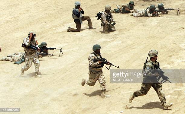Thousands of Iraqi soldiers take part in a training exercise led by the Spanish Army and under the guidance of the US military in the Basmaya camp in...