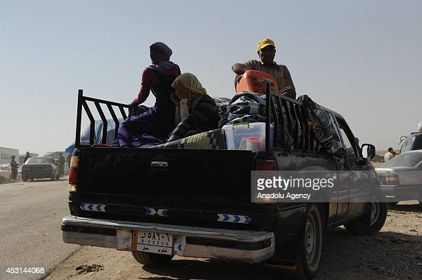 Thousands of Iraqis flee from the town of Sinjar near the city of Mosul to Erbil after armed groups affiliated with the Islamic State of Iraq and the...