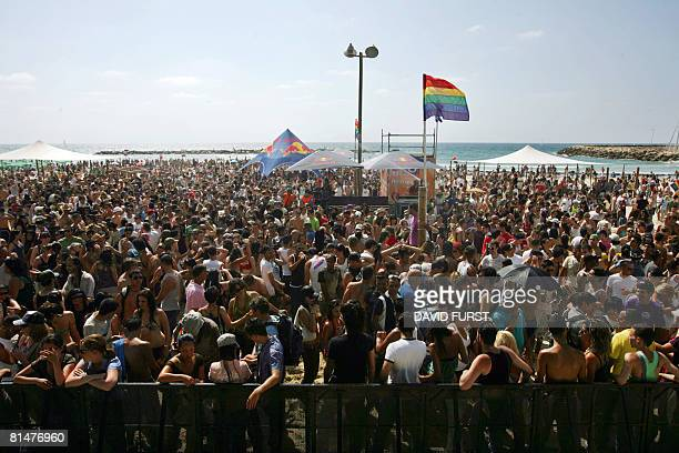 Thousands of Israelis and foreigners gather on the beach in Tel Aviv on June 6 as part of this year's Gay Pride Parade The parade a celebration of...