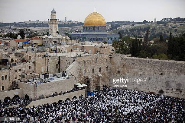 Thousands of Israelis attend the Annual Cohanim prayer or Priest's blessing for the Pesach holiday on April 21 2011 at the Western Wall in...
