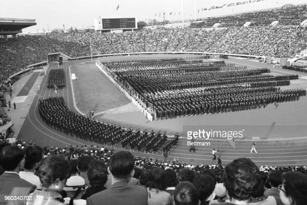 Thousands of Japanese schoolchildren take the place of the competing athletes in this dress rehearsal for the opening ceremonies of the 1964...