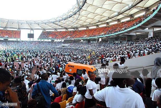 Thousands of jobseekers wait to take an exam in Abuja National Stadium where they came to apply for work at the Nigerian immigration department in...