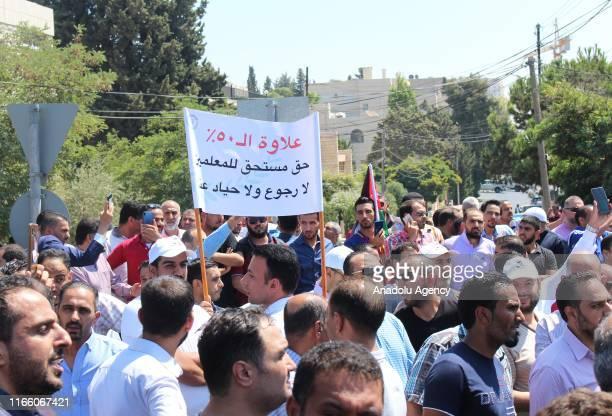 Thousands of Jordanian teachers gather near government headquarters, during a demonstration demanding 50% hike in their salaries in Amman, Jordan on...