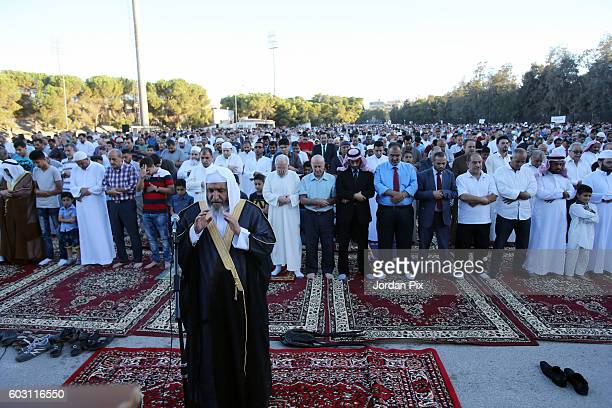 Thousands of Jordanian worshippers attend a central Eid Al Adha prayer at King Hussein sports city on September 12 2016 in Amman Jordan Monday marks...