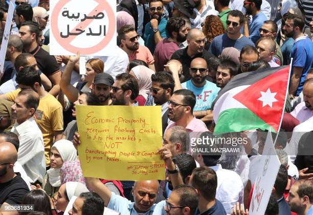 Thousands of Jordanians take to the streets of Amman on May 30 2018 to protest against a new income tax draft law which was approved by the...