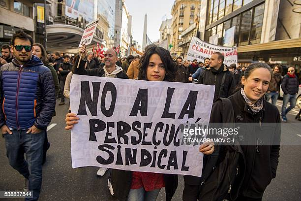 Thousands of journalists from dozens of media workers' unions protest on June 8 in Buenos Aires demanding that media companies end dismissals against...