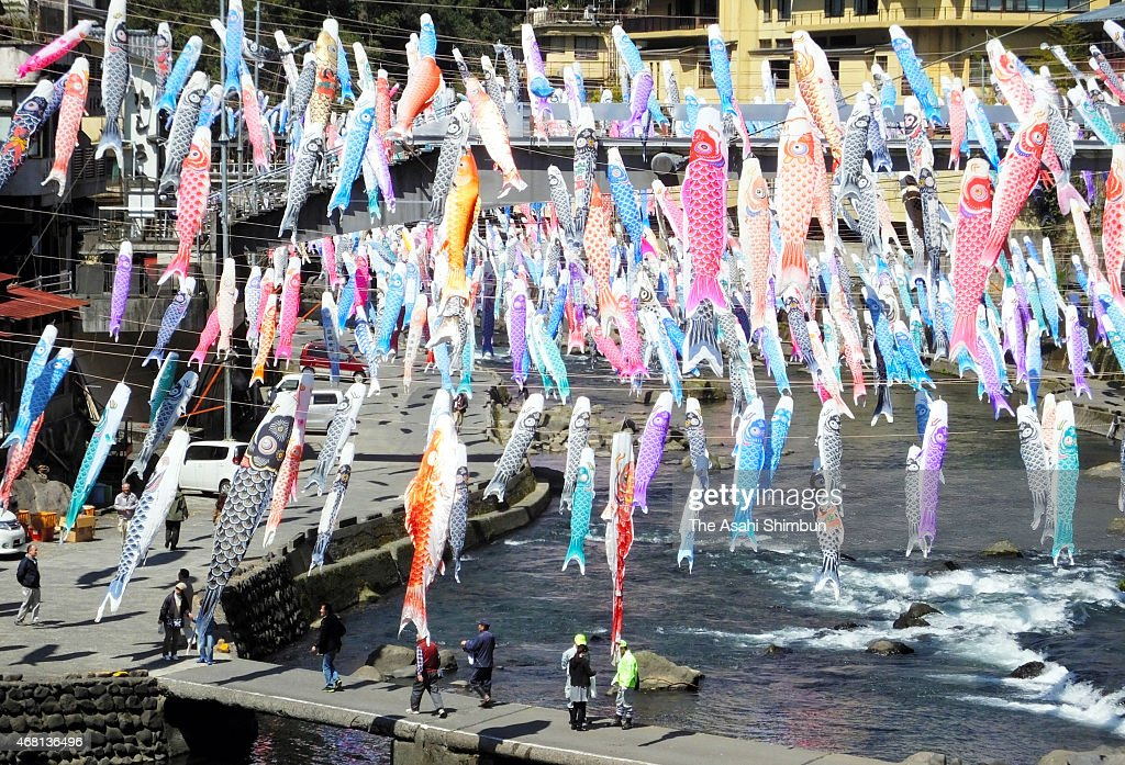 Thousands of 'koinobori' carp streamers fly above the Tsuetate hot spring resort on March 26, 2015 in Oguni, Kumamoto, Japan. Preparations for a local festival featuring koinobori, large carp banners flown outside throughout Japan to celebrate traditional Boys' Festival in May, were made on March 26.