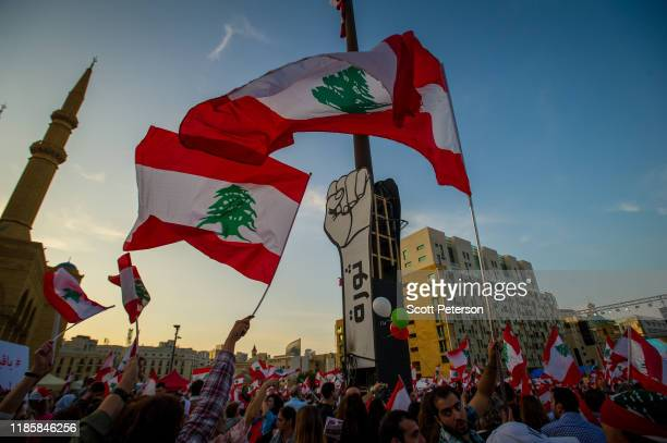 Thousands of Lebanese protesters wave flags and rally against sectarian government and call for the removal of the country's entire political class,...