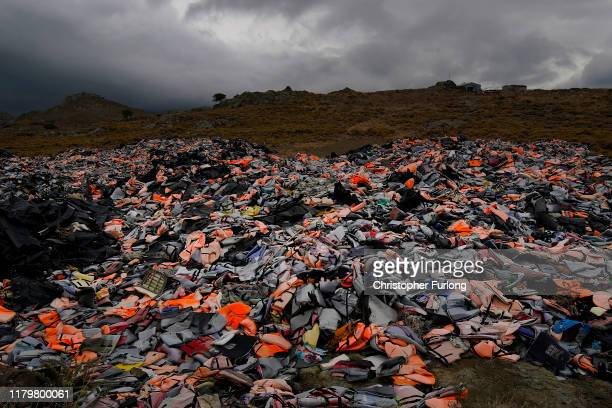 Thousands of Life jackets and rubber boats abandoned by migrants who have made the crossing from Turkey to the Greek island of Lesbos are dumped on...