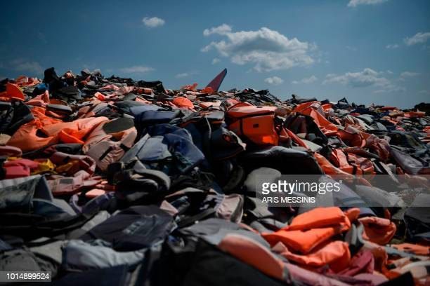 Thousands of life jackets used by refugees and migrants during their journey across the Aegean sea lie in a dump in Mithymna on the Greek island of...