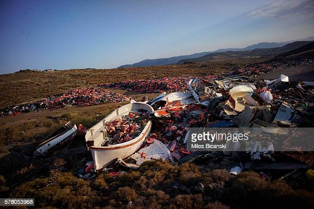 Thousands of life jackets used by refugees to cross the Aegean sea from Turkey to Greece last year are left discarded amongst boats on July 18 2016...
