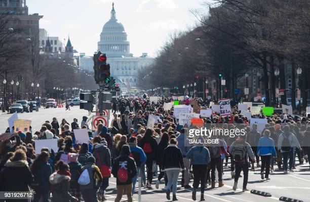 Thousands of local students march down Pennsylvania Avenue from the White House to the US Capitol during a nationwide student walkout for gun control...