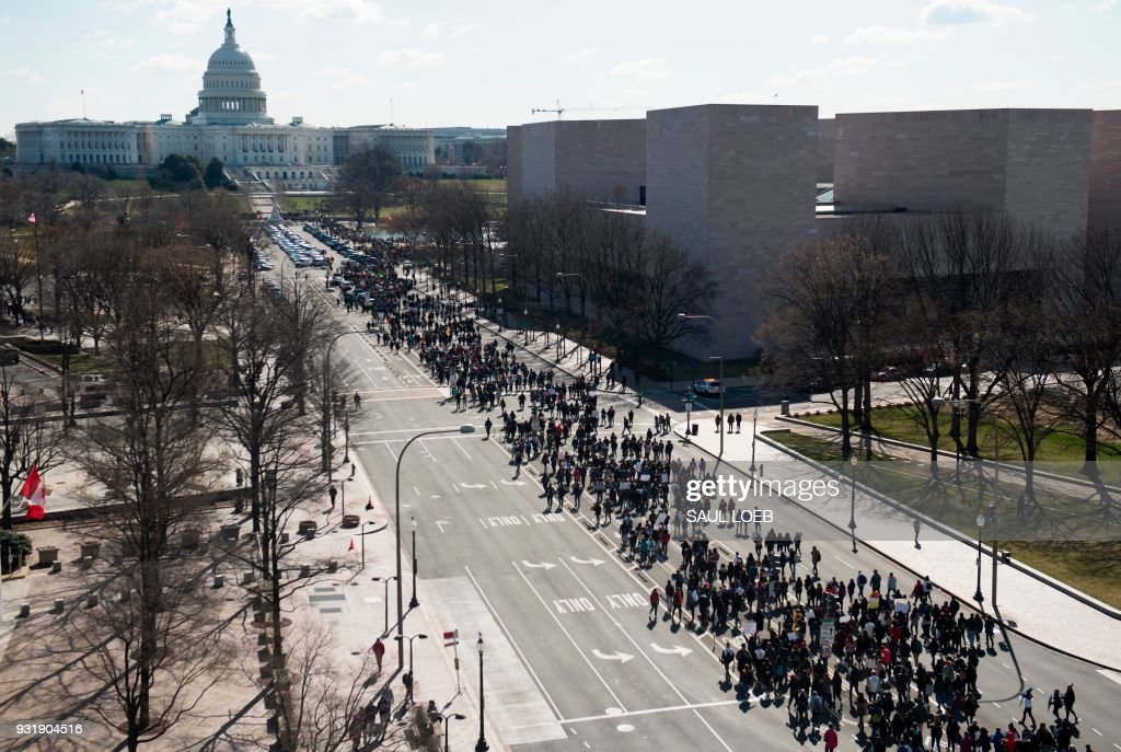 Thousands of local students march down Pennsylvania Avenue to the US Capitol during a nationwide student walkout for gun control in Washington, DC, March 14, 2018. Students across the US walked out of classes on March 14, in a nationwide call for action against gun violence following the shooting deaths last month at a Florida high school. The nationwide protest is being held one month to the day after Nikolas Cruz, a troubled 19-year-old former student at Stoneman Douglas, unleashed a hail of gunfire on his former classmates. /
